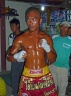 A Thai kick boxer is getting ready for the fight