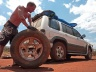 Changing the tyres in the heat of the day